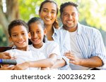 happy indian family outdoors... | Shutterstock . vector #200236292