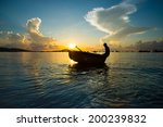 Fishermans Sits On A Boat In...