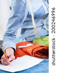 tailor correcting a project... | Shutterstock . vector #200246996