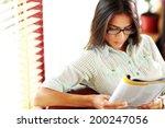 businesswoman reading magazine... | Shutterstock . vector #200247056