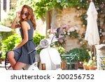 beautiful italian woman sitting ...   Shutterstock . vector #200256752