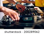dj hands on equipment | Shutterstock . vector #200289062