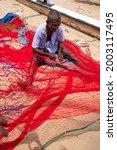 A Fisherman Stitching And...