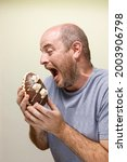 A Man Eating A Chocolate Candy. ...