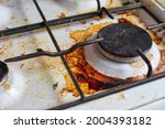 Dirty Stove With Food Leftovers....