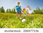 happy kids playing football in... | Shutterstock . vector #200477156