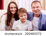 Portrait Of Happy Family Of...
