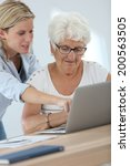 homecarer with elderly woman... | Shutterstock . vector #200563505