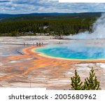 Grand Prismatic Spring in Yellowstone National Park with vivid colors and tourists