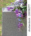 Silk Flowers On A Cemetery...
