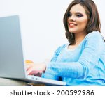 young woman working at laptop... | Shutterstock . vector #200592986