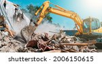 Small photo of Demolition of building. Excavator breaks old house. Freeing up space for construction of new building