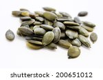 Pumpkin Seeds Isolated On Whit...