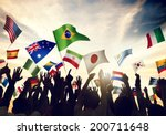 Group Of People Waving Flags I...