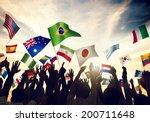 Group Of People Waving Flags In ...