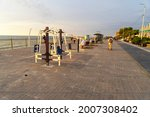 The promenade or embankment of the city of Zelenogradsk paved with paving slabs along the Baltic sea at sunset, Kaliningrad region, Russia. Walks and relaxation near of the sea. Outdoor fitness
