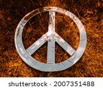 Wide close shot of Peace Sign for nuclear disarmament set against a fiery orange grass background