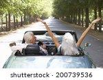 senior couple in sports car | Shutterstock . vector #200739536