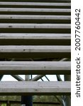 Old gray wooden stairs. Diagonal lines. Abstraction. From big to small stripes. High quality photo