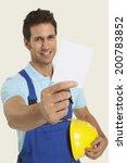 man in overall holding blank...   Shutterstock . vector #200783852