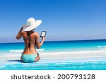 girl with white hat reads... | Shutterstock . vector #200793128