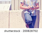 a young man using a smartphone... | Shutterstock . vector #200828702