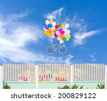 Fence And Balloons With Bicycl...