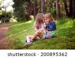 two little sisters hugging... | Shutterstock . vector #200895362