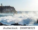Big Waves Breaking On Rocks
