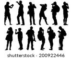 man and women with a camera on...   Shutterstock .eps vector #200922446