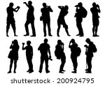 man and women with a camera on... | Shutterstock . vector #200924795