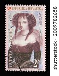 Small photo of ZAGREB, CROATIA - AUGUST 29, 2014: A stamp printed in Croatia shows Flora Zuzzeri (Cvijeta Zuzoric, 1552-1648), Series Europa (C.E.P.T.) 1996 - Famous Women, circa 1996