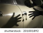 Car thief at parking lot - stock photo
