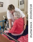 Care Giver Helping Elderly...