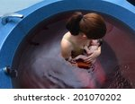 young woman holds her baby in a ... | Shutterstock . vector #201070202