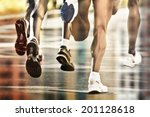 runners on wet ground with city ... | Shutterstock . vector #201128618