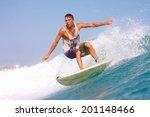surfing a wave. lombok island....   Shutterstock . vector #201148466