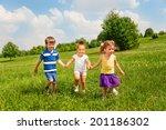 three happy children holding... | Shutterstock . vector #201186302