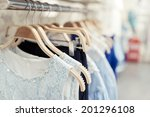 Stock photo shop with different clothes shopping racks and shelves 201296108