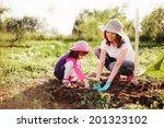 family in the garden. | Shutterstock . vector #201323102