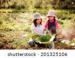 family happy in garden. | Shutterstock . vector #201325106