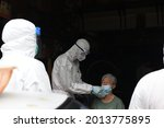 Small photo of Thailand : 25 July 2021 monk from Wat Sutthi Wararam with using rapid antigen test for initial screening of COVID-19 for people In the community near Wat Sutthi Wararam with in Bangkok.
