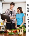 happy  couple cooking with... | Shutterstock . vector #201401132