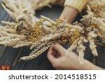 Hands making stylish autumn...