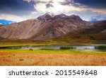 Lake in valley (Valle Hermoso) at foot of Andes mountains on summer day. Andes, Argentina