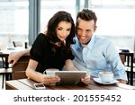 two young colleagues enjoying a ... | Shutterstock . vector #201555452