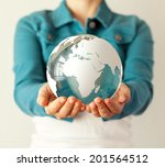 Woman Holds Glass Earth In Her...