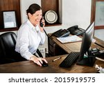 female receptionist working at... | Shutterstock . vector #2015919575