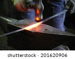 Blacksmith Making Sword In A...