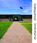 Small photo of Sullivan's Island, South Carolina -2021: Fort Moultrie National Historic Park. Sally Port (entrance) to the fort along with the Moultrie Flag or Liberty Flag. Fort Moultrie defended Charleston Harbor.